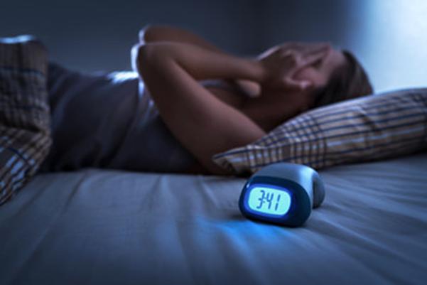 Personne stressée au lit - Sleepzen